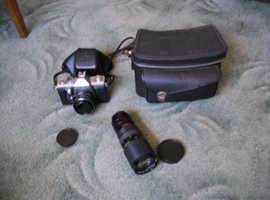 Film Camera With Telephoto Lens.
