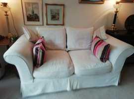 Two comfortable cream fabric sofas