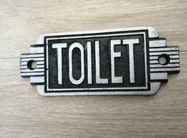 Art Deco style cast iron toilet door sign