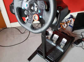 Logitech G29 racing wheel, pedals and stand.