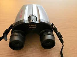 Compact high power binoculars