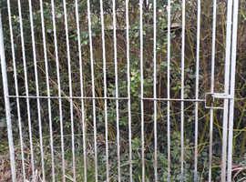 Metal dog run panel with door