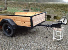 Refurbished used trailer with cover