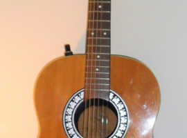 Roundback Semi Acoustic Guitar.  Priced to clear. Neck bowed, only issue