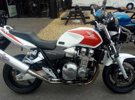 As New. 2004 Honda CB1300F3 Red/White. Only 8,495 miles. Stunning. Completely Original.