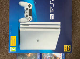 PS4 pro 1tb console white with 2 games