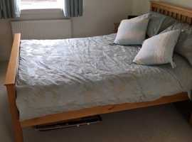 Solid oak bed frame with mattress ( if required).  Modern look.