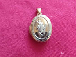 Gold 9ct St Christopher opening locket.