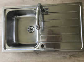 Stainless Steel sink with fitted taps