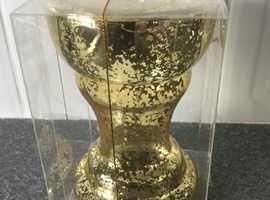 Brand new Gold effect Candle holder and gold candle included