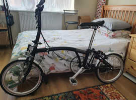 Brompton folding bike 2 speed.  As good as new. comes with accessories worth over £100
