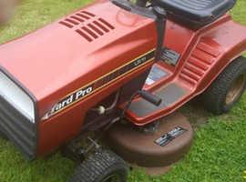 Ride on lawn mower.