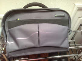 A collection of travel items including suit carrier
