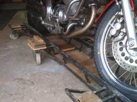 Yamaha Virago 535 Motorcycle with leather saddle bags and tool bag.