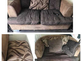 Two seater sofa, large rotating arm chair and storage ottoman