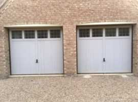 TWO MATCHING GREY SOLID WOOD GARAGE DOORS ONE ELECTRIC SOLD