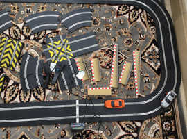 Scalectrix set with 2 cars, extra track, chicane, crossover track, jumps and barriers.
