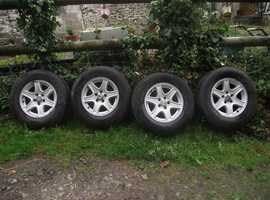 16'' Jeep alloys x 4 with high quality uniroyal wet weather tyres