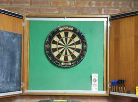 Winmau dartboard with wooden cabinet.