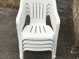 4  white chairs