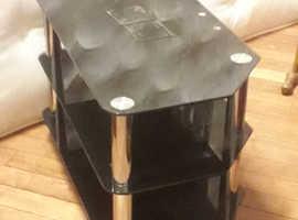 Glass TV stand with shelf