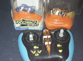 2 like new and 1new rc fish with tank put in cheaper still Available for offers