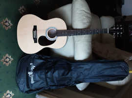 Martin smith guitar with fishman preamp /tuner fitting slight lacquer damaged ..as new condition