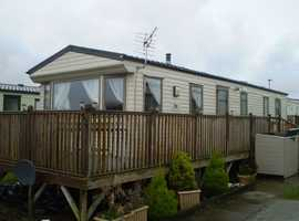 great example of a WILLERBY RIO GOLD including decking 35x12 3 bed