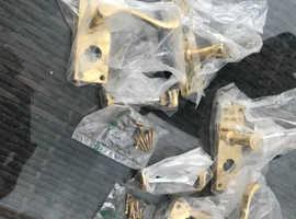 Brand new, in box, 2 sets of brass security door handles