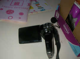 lovely camcorder by sanyo with charger leads for battery