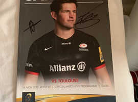 Signed match day programme from saracens vs Toulouse
