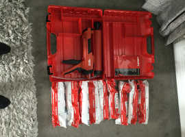 BRAND NEW HILTI GUN WITH 9 PACKS OF RESIN