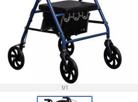 Mobility aid , rollator with brakes & seat attached , ex. Cond