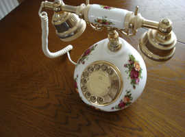 A Royal Albert (Country Rose) Telephone.