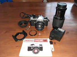 Pentax ME Super SLR Camera + 75mm - 205mm Zoom lens + accessories.
