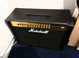 Marshall Guitar amplifier, foot switch and multi effects pedal with Gibson guitar strap.