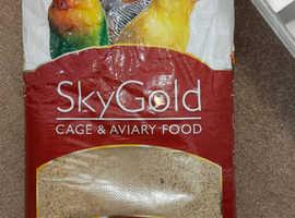 Unopened bag of bird food (grains )