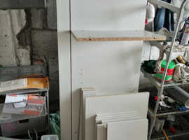 Various pieces of white units. 2 large side panels and shelves