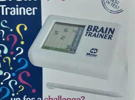 Brain Trainer game by Mensa, brand new in unopened box.
