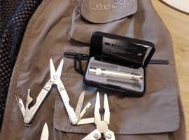 Fly fishing vest,maglite,leatherman multi tool