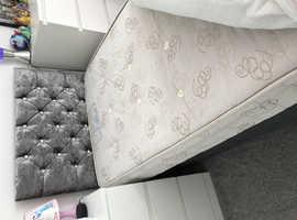 Single grey divan bed with headboard