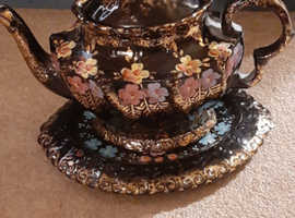 Antique black floral teapot