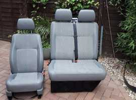 Set of front seats removed from a 2009 Transporter T5.