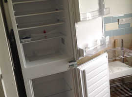Integral fridge freezer