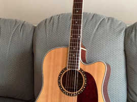 Electro-acoustic guitar with cutaway