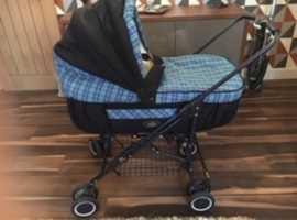 Baby pram/pushchair combination.