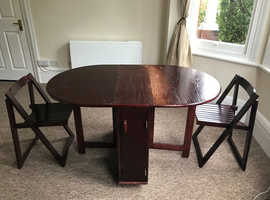 Folding Dining Table with 4 chairs.