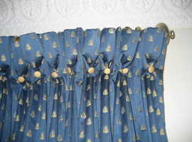 Beautiful blue goblet pleated and interlined curtains with a gold scarab on this Monkwell fabric.