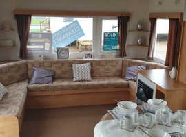CHEAP static caravan for sale by the seaside!