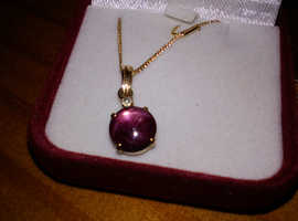 Star Ruby and white diamond 18ct gold necklace